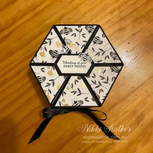 hexagonal gift box with bees in black, gold and white