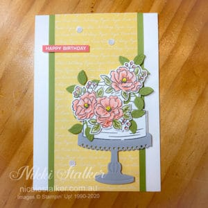 Greeting card of a birthday cake with layered flowers