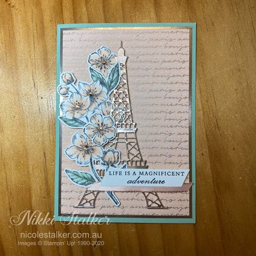 Greeting card with Eiffel Tower and cherry blossoms