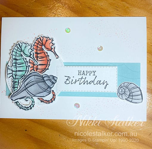 Birthday card with seahorses and shells